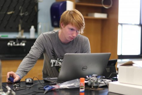 "Senior Stefan Gregg works on programming a song with the Arduino. ""We have to learn how to put a Breadboard together and attach it to the Arduino to bring the code into it,"" Gregg said. ""If you have any music knowledge, you use that to get the correct notes."""