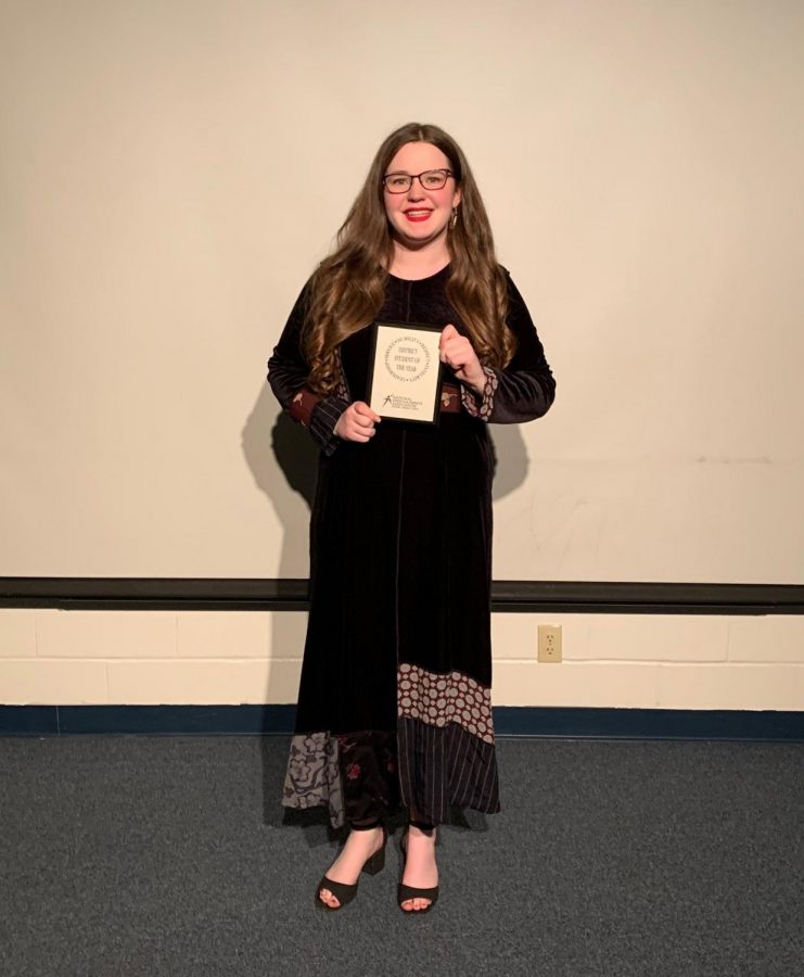 Bass+stands+with+her+award.+She+is+one+of+the+few+students+in+recent+memory+from+Lindale+that+has+been+awarded+district+student+of+the+year.+