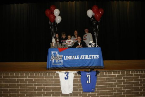 Senior Connor Boyette and his family stop for a picture after Boyette signs to become a preferred walk-on for college football. He will continue his career at Lamar University.