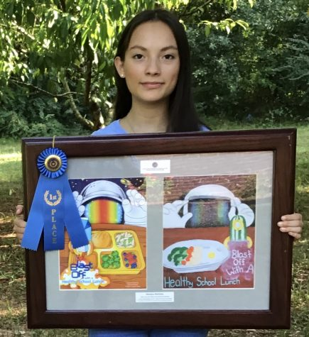 Sophomore Mariana Martinez presents her art work.
