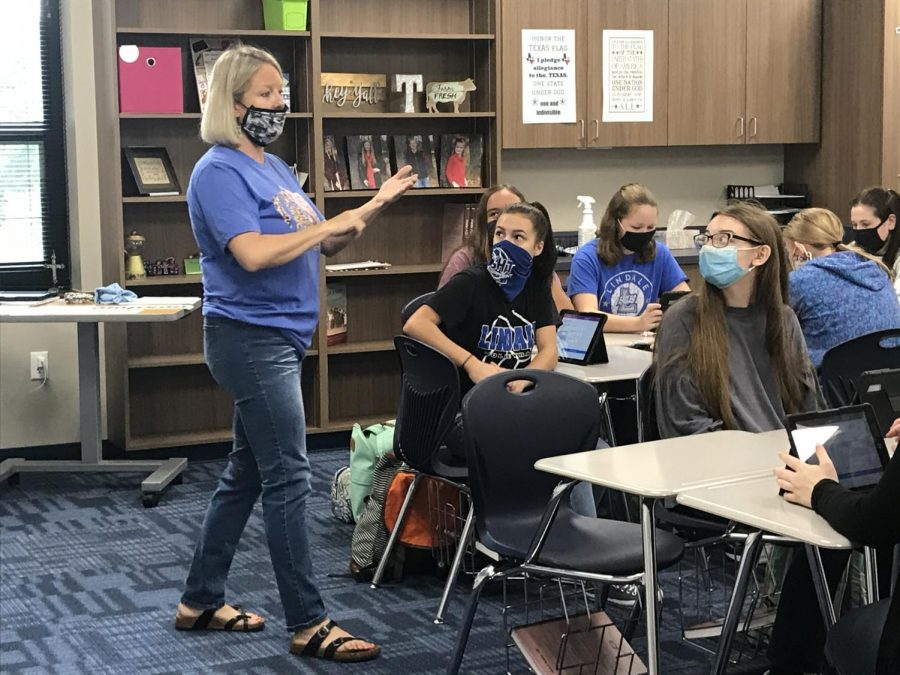 "Amy Thompson instructs her students to start reading in sign language. ""There was a push to get a few more foreign language options and Mr. Chilek was aware that I knew sign language,"" Thompson said. ""I feel like it is my dream job."""