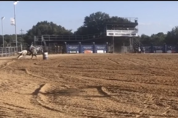 Freshman Alandria Jones takes the reigns of her horse and competes in a barrel race.