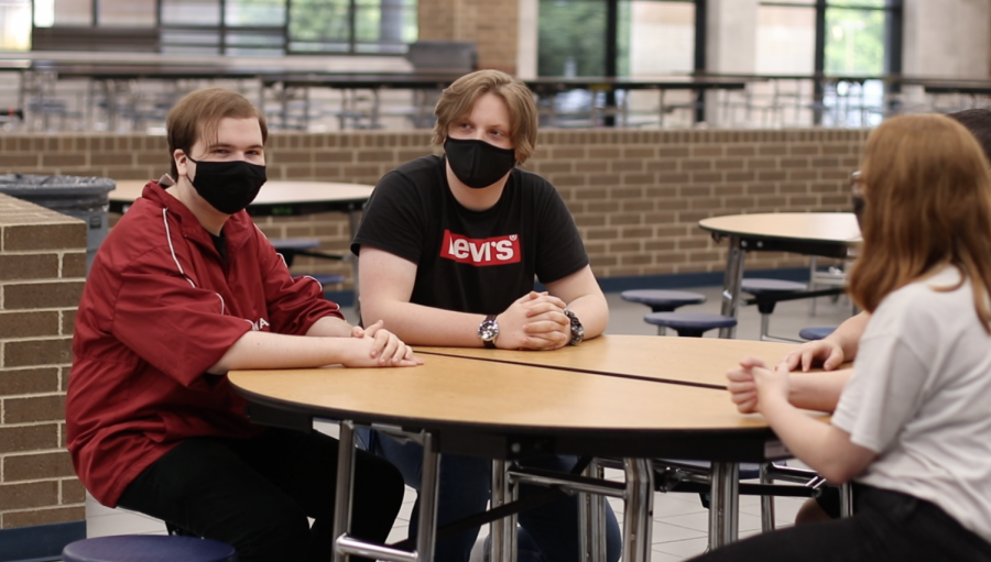 Seniors Zachary Jones and John Park sit across from sophomore Kylie Hester wearing their masks appropriately. Over the nose and secured under the chin is the most scientifically proven method by which masks should be worn.