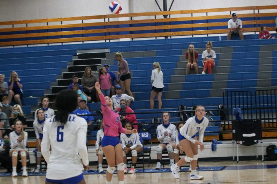 Senior Marleigh Thurman hits the volleyball over the net. The Lady Eagles 6-0 undefeated in district.