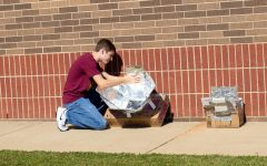 Senior Ferris Turney checks the temperature on his solar oven. If the solar rays are not heating it up properly, then he will have to redesign.