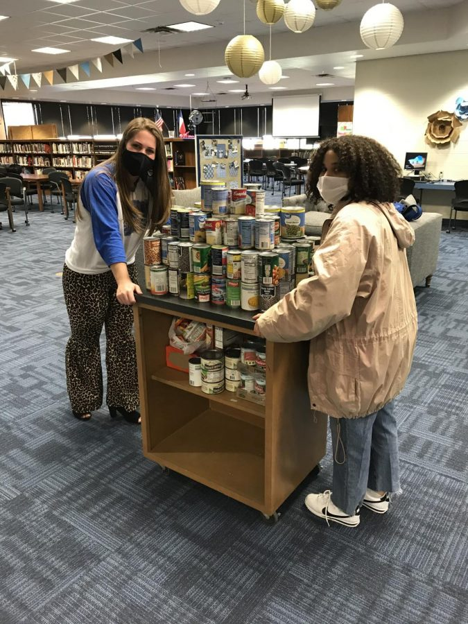 Members of the student council loads cans to transport to the David Powell Food Pantry. All cans will be donated to the pantry and distributed to families in need.