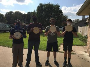 Junior Cody Peters and friends shows off the sculpting wheels for his Eagle Scout project and the art department.