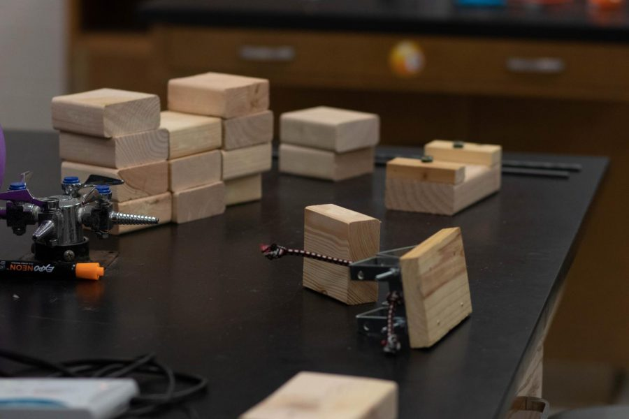 The tools that the robotics students have been working with lay on a lab table. Students are asked to design a robot that can move 'infected' wooden blocks as well as market the robot to 'consumers' at the UIL BEST competition.