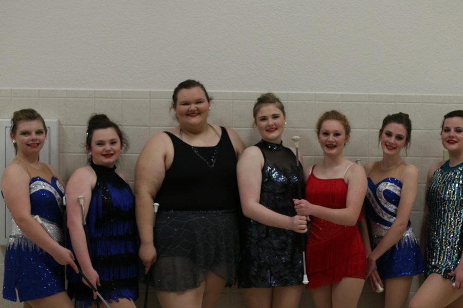 The twirlers pose after competing in their solos. All the twirlers advanced to state in their ensembles and four advanced in their solos.