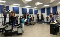 The chorale group practices for their all region competition.