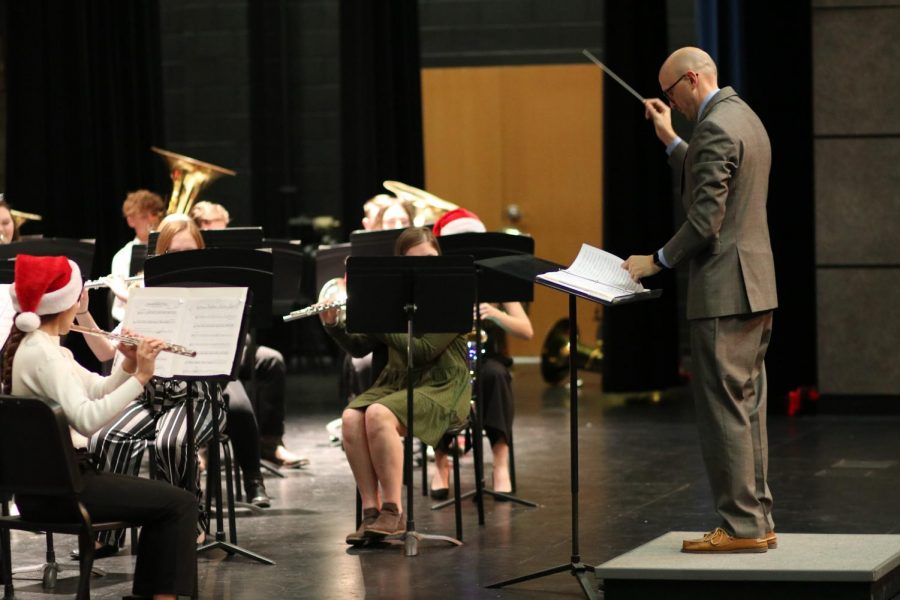 Weston Fisher directs the symphonic band during the Christmas concert. The Chistmas concert was the last thing the band did before they started preparing for the UIL Solo and Ensemble contest.