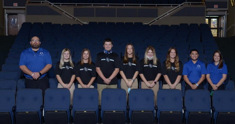 Head trainer, Travis Gray, poses here with his student trainers and assistant staff trainers at picture day in the Fall.