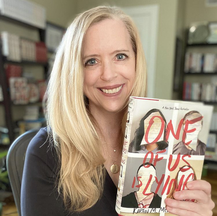 Author Karen M. McManus holds up her copy of One of Us is Lying. Her book has been on the New York Times Best Sellers List in the category Young Adult Hardcover for 160 weeks.
