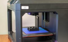 The 3D printer works on printing a tablet holder.