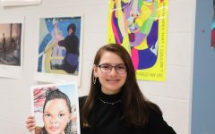 Freshman Alisa Thane poses with her student portrait.