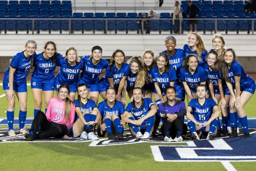 The varsity girls soccer team poses for a picture. This was taken after a game.