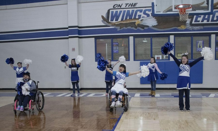 "The Pathfinders practice their cheer during their P.E. class. ""I just want everybody to know not to underestimate our students with special needs,"" adaptive P.E. teacher Christy Bateman said. ""They have such joy in life and they really set their bars high. I want to be the best that I can be for them and just offer opportunities to have fun and be joyous and to just love life."""