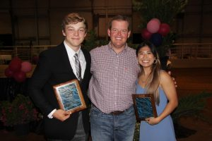 Seniors Janet Allen and Rebekah Beard stand next to principal Jeremy Chilek. The two were awarded the Chamber of Commerce Student of the Year Award earlier this month.
