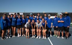 Tennis team poses for a picture after the regional quarter finals.