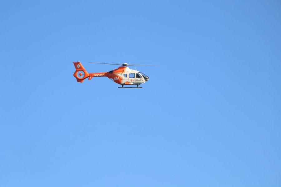 The EMT helicopter flies in from UT Health.