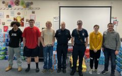 5th Period Law II students pose with Lindale Fire Chief Joe Yeakley and volunteer John Nilson during their visit to the high school.