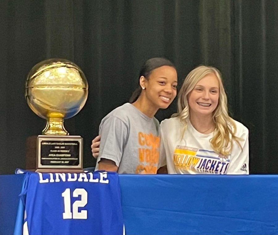 """Seniors Lily Chamberlain and Kalaya Pierce signed to play sports at the college level on April 22. Pierce signed to play volleyball at Cedar Valley College and Chamberlain will play basketball at LeTourneau University. """"I am very excited for both of these young ladies to have the opportunity to go compete at the next level,"""" basketball coach Daniel Devisscher said. """"Going to college to play sports is not easy as very few are chosen, they understand what it takes and are willing to put the work in to be great."""" The two girls played together on the basketball team reaching a regional quarterfinals title in the playoffs. Chamberlain, a shooting guard, will continue that legacy of basketball excellence in college at LeTourneau in Longview, Texas.  """"I chose LeTourneau because of the environment and how close it was to home,"""" Chamberlain said. """"I just really fell in love with the coaches and my teammates in Longview."""" Pierce played for the girls varsity volleyball team last fall where the team went undefeated throughout district, competing in the playoffs. Pierce is continuing her education and volleyball career at Cedar Valley College in Lancaster, Texas. """"I chose Cedar Valley because I love the team and how truly accepting they were,"""" Pierce said. """"They really just brought me in and made me feel like I was just at home."""""""