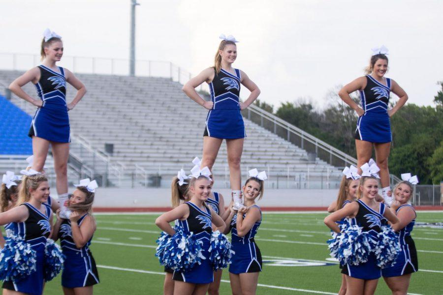 The varsity cheerleaders perform at Meet the Eagles.