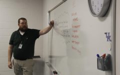 Mr. McKenzie is lecturing debate students to get them ready for the school year.