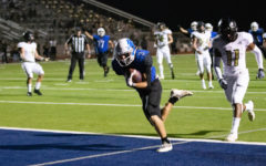 Senior Jacob Seekford scores a touchdown in the first quarter of the game against Kaufman. Seekford caught seven passes and totaled 135 yards.