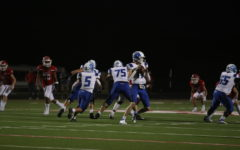 Quarterback Sam Peterson gets ready to pass the ball.