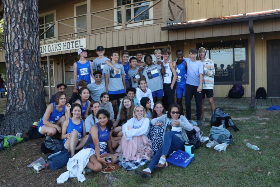 The cross country team poses for a photo after a meet. Both the boys and girls teams are featured here. Photo by Julia Montgomery