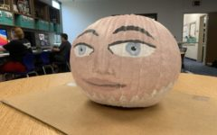 Yearbook students create their pumpkin for the contest. (Photo by Henrique Arantes)