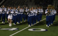 The band marches during halftime at the Chapel Hill game. We have such a difficult drill, sophomore Maddi Farmer said. I think we did really well tonight.